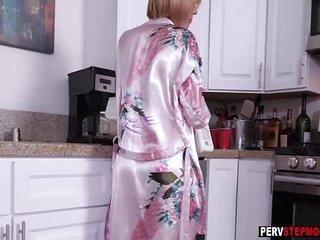 MILF stepmom sucks a stepsons hard dick for a breakfast