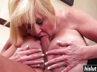 A Busty MILF in stockings gets fucked and have her huges tits fucked