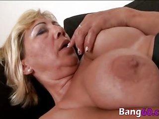 Busty granny enjoys interracial fucking