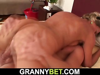 Older blonde woman enjoys riding his dick