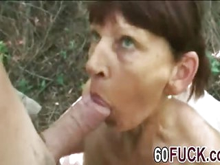 Mature busty brunette lady fucked hard in the forest