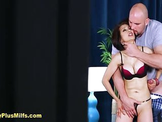 Hot mature Kim Anh gets huge cock from a big burly shaved head man with stiff erection