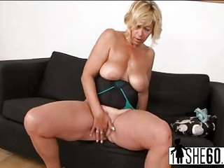 Mature blonde masturbates and rides BBC