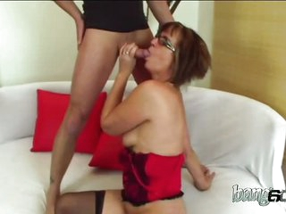 Mature woman sucks and gets drilled by her young buddy