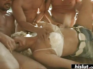 Mature lady blowing two fat dicks